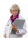 Stehender Frauen-Doktor Looks Askance Lizenzfreies Stockfoto