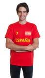 Stehender spanischer Sportfan mit dem schwarzen Haar stockbild
