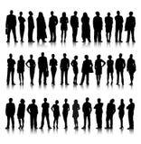 Stehendes Schattenbild der Menge der Geschäftsleute Stockfotografie