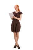 Stehendes Schreiben der jungen Frau Stockfoto