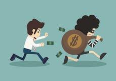 Stehlen Sie Geld vom Geschäftsmann Stockfotos