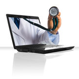 Stehoscope. A doctor's hand sticking out of a laptop Stock Photos