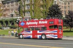 Steigen Hopfen weg vom Bus auf Victoria, Vancouver Island, Kanada ein Stockbild
