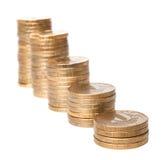 Steigende Spalten von den Münzen Stockbilder