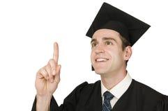 Steigender Finger des Absolvent auf Weiß Stockbild