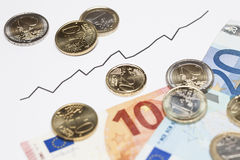 Steigendes Diagramm und Geld Lizenzfreies Stockfoto