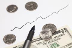Steigendes Diagramm und Geld Stockfotos