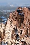 Steiler Felsen im Winter Stockbilder