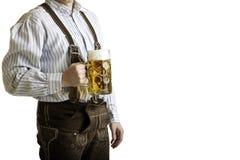 Stein bavarese della birra della stretta dell'uomo a Oktoberfest Fotografia Stock