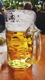 Stein of beer in bierkeller, Munich stock photos