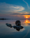 Stein bei Sonnenuntergang Stockfoto