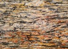 Stein- buntes grafisches Muster oder Hintergrund des Gneises Lizenzfreies Stockbild