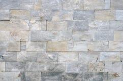 Stein deckt Beschaffenheit mit Ziegeln Stockfotografie