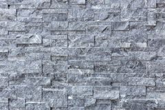 Stein deckt Hintergrund mit Ziegeln Stockbild