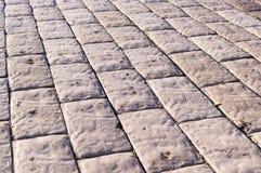 Stein gepflasterte Straße mit Perspektive Hintergrund, Beschaffenheit Stockfotografie