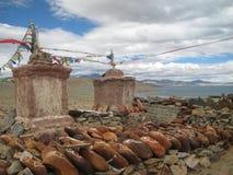 Stein geschnitzt mit Symbolen von prosperity_5 Stockbild