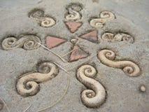 Stein-Kunst auf dem Boden Stockfoto