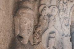 Stein-Kwan Yin-Skulptur in der Höhle Lizenzfreie Stockfotos