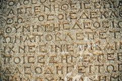 Stein mit antiken griechischen Beschreibungen Stockfoto