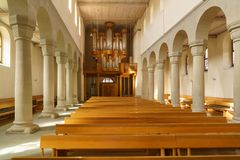 Stein am Rhein, Switzerland - October 16, 2017: The austere interior of a modern Protestant Swiss church. With an organ and wooden benches royalty free stock photography