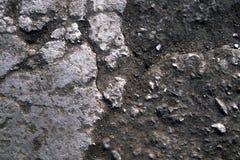 Stein- und Bodenbeschaffenheitshintergrund mit Staub und granulierten Partikeln Schließen Sie oben Makro des rustikalen Geländes stockfoto