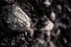 Stein von einer Wand Stockfoto