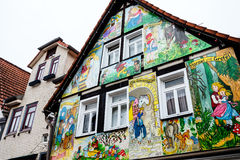 STEINAU, GERMANY-MARCH 06, 2015:  Painted house with scenes from the Grimm fairy tales. Painted house in the fairy tale town Steinau an der Straße, with scenes Royalty Free Stock Photo