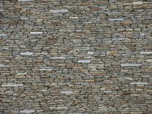 Steinbacksteinmauer in den hellen Farben stockfotos