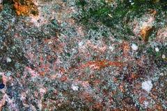 Steinbeschaffenheit als rauer Hintergrund des abstrakten Schmutzes mit gesprenkelten Farben Natürliche Hardrockoberfläche Alte Me Lizenzfreie Stockfotografie
