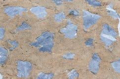 Steinbeschaffenheit, mit Zementwandhintergrund Lizenzfreie Stockfotografie