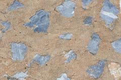 Steinbeschaffenheit, mit Zementwandhintergrund Stockbild