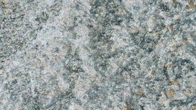 Steinbeschaffenheits-Hintergrund Strzegom-Granit Lizenzfreies Stockfoto