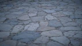 Steinboden mit einigem Staub und kleinen Steinen Stockbilder