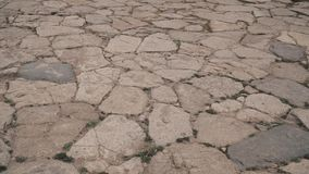 Steinboden mit einigem Staub und kleinen Steinen Lizenzfreies Stockfoto