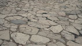 Steinboden mit einigem Staub und kleinen Steinen Stockfotos