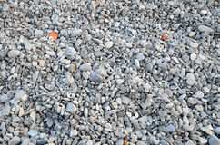 Steine auf dem Strandhintergrund Stockbild