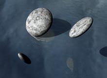 Steine auf einem grauen Hintergrund Stockfotografie