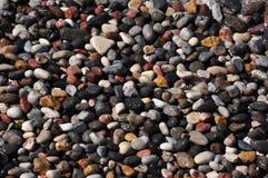 Steine auf einer Küste Stockfotos
