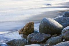 Steine auf Strand Stockfoto