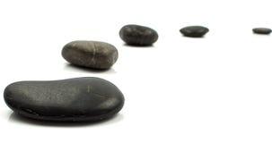 Steine auf Weiß Stockfoto