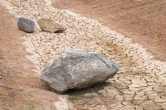Steine in einem trockenen Fluss Lizenzfreies Stockbild