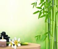 Steine, Wachs, Blume und Bambus auf dem Tisch Lizenzfreie Stockfotos
