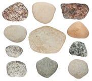 Steine werden auf einem weißen Hintergrund lokalisiert Stockfoto