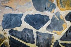 Steinfelsenwandhintergrund Stockfotografie