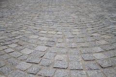 Steinfliesen auf der Straße Stockfoto