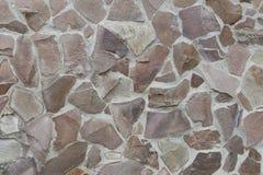 Steinfliesenbeschaffenheitsbacksteinmauer Stockfoto