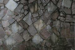 Steinfliesenbeschaffenheitsbacksteinmauer Stockfotografie