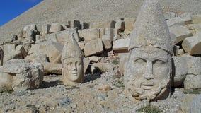 Steinköpfe auf dem Nemrut Dagi die Türkei lizenzfreie stockfotografie