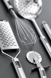 Steinless kitchen stuff on gray background Royalty Free Stock Photos
