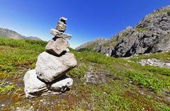 Steinmann in den Alpen Stockfoto